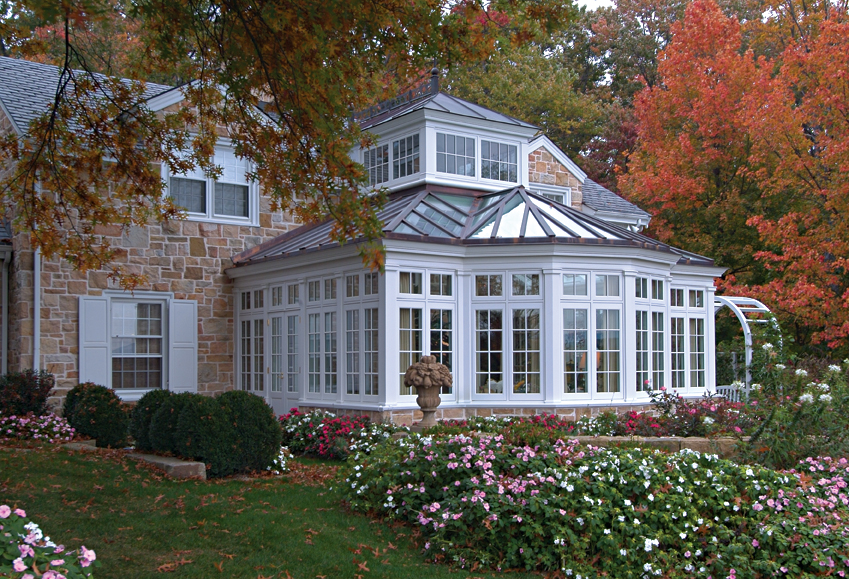 A Colonial Stone House With Traditional Conservatory